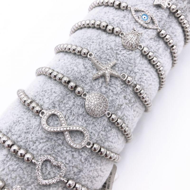 SOGGETTI assortiti con acciaio zirconi - Braccialetti elastici 10 pz